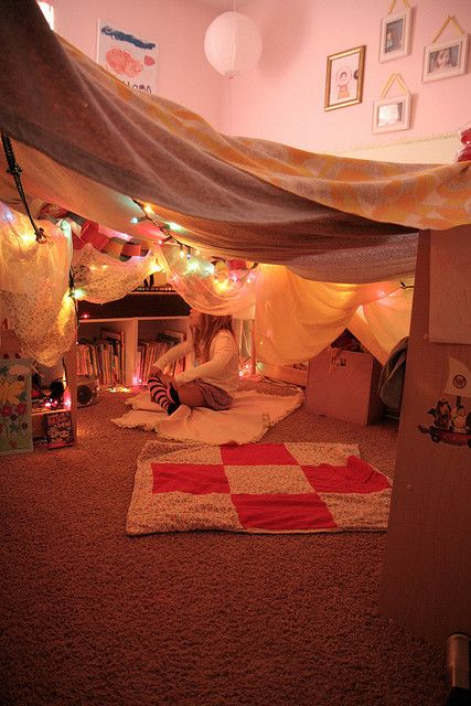 adorable bedroom fort.  i used to make these when i was little.  and i would still love to make one today :)
